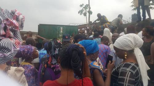 Pregnant-Woman-Chokes-Another-Woman-Coughs-Up-Blood-As-Police-Tear-gas-Lagosians-Seeking-PVCs-PHOTOS1.jpeg