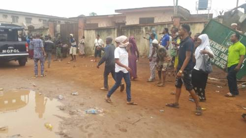 Pregnant-Woman-Chokes-Another-Woman-Coughs-Up-Blood-As-Police-Tear-gas-Lagosians-Seeking-PVCs-PHOTOS2