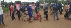 OMG! FUOYE Students Spotted 'KILLING' A Policeman During A Protest [VIDEO]
